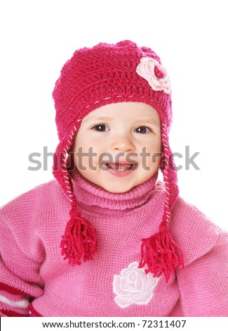 Portrait of cute happy laughing baby girl in funny pink hat isolated on white background - stock photo
