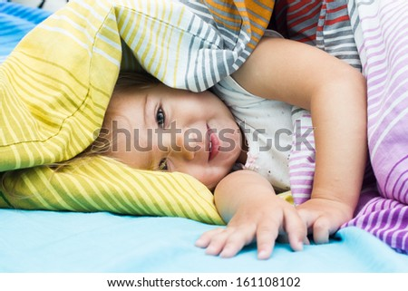 Portrait of cute happy little girl after sleep. - stock photo