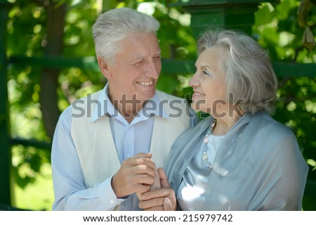 Portrait of cute happy senior couple outdoors