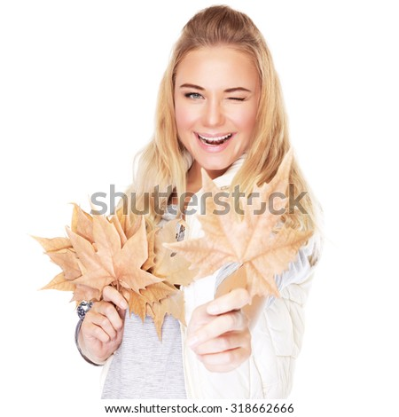 Portrait of cute joyful girl with dry leaves bouquet in hands isolated on white background, happy autumn season