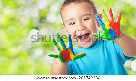 portrait of cute <b>kid playing</b> with paint - stock photo - stock-photo-portrait-of-cute-kid-playing-with-paint-201749336
