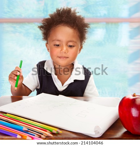 Portrait of cute little African preschooler on drawing lesson, have big fresh red apple for lunch in the school, elementary education concept - stock photo