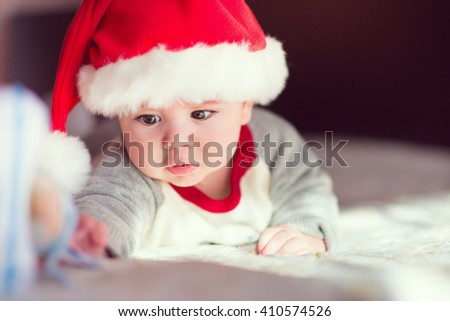Portrait of cute little baby boy in red  Santa Claus hat - stock photo