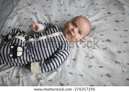 Portrait of cute little baby on blanket - stock photo