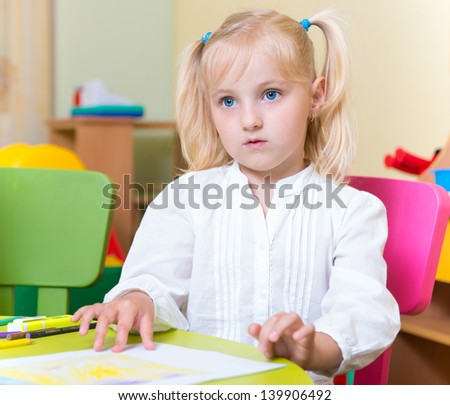 Portrait of cute little blonde girl with blue eyes - stock photo