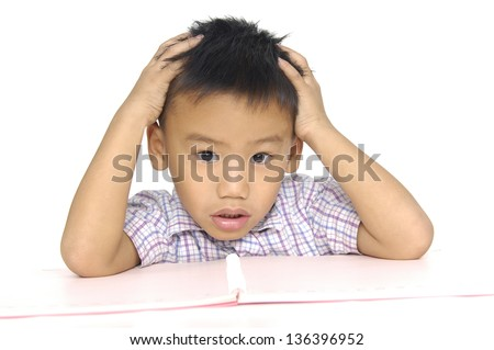 portrait of cute little boy expressing with his hands in his face