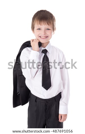 portrait of cute little boy in business suit isolated on white background