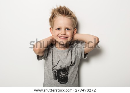 Portrait of cute little boy posing. Studio portrait over white background - stock photo