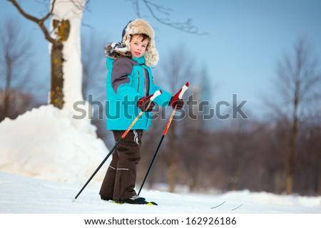 Portrait of cute little boy skiing on cross - stock photo