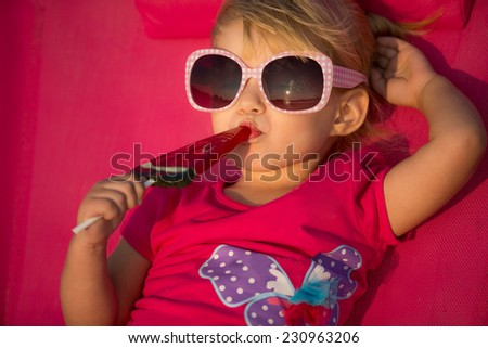 Portrait of cute little girl at tropical beach - stock photo