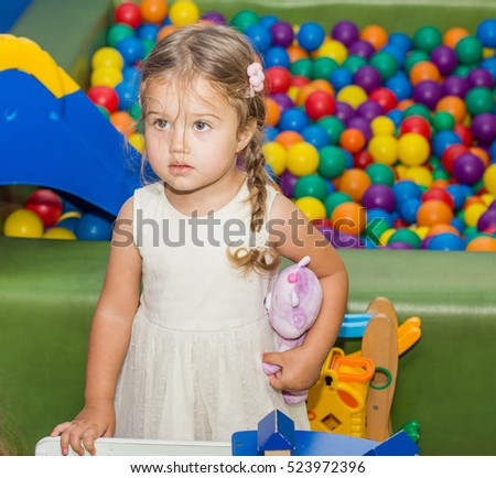Portrait of cute little girl in playground.