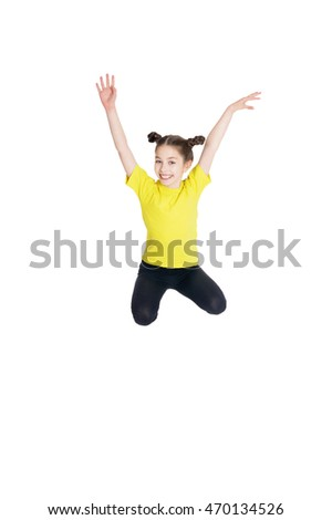portrait of cute little girl jumping