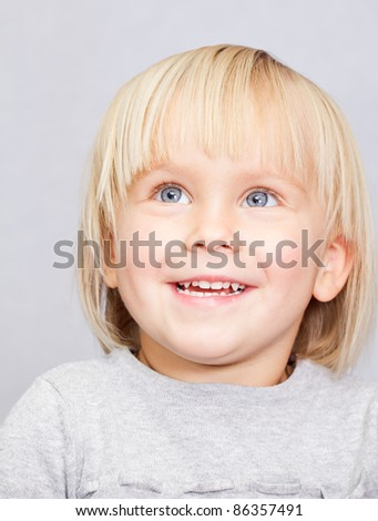 Portrait of cute little girl looking up - stock photo