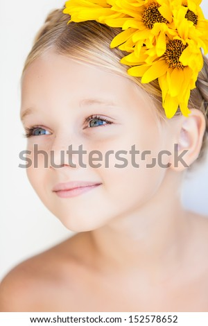 portrait of cute little girl over white background in summer day - stock photo