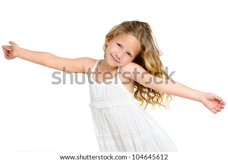 Portrait of cute little girl with arms wide open. Isolated on white background.