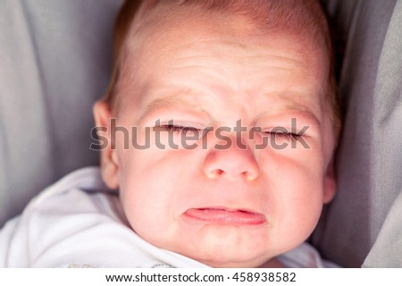 Portrait Of Cute 4-Month Baby Boy Crying  - stock photo