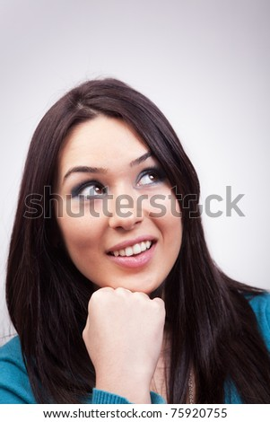 Portrait of cute pensive woman having happy thoughts
