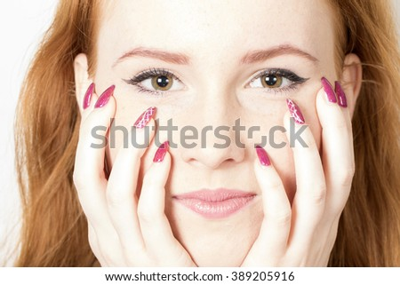 portrait of cute redheaded girl with stylish nails - stock photo