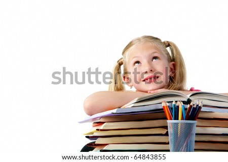 Portrait of cute schoolgirl keeping her arms on open book and looking upwards