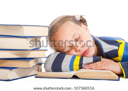Portrait of cute schoolgirl  sleeping over the book on isolated white background