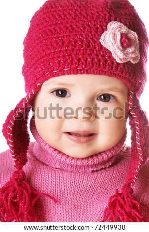 Portrait of cute smiling baby girl in funny pink hat isolated on white background - stock photo