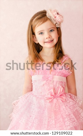 Portrait of cute smiling little girl in princess dress - stock photo