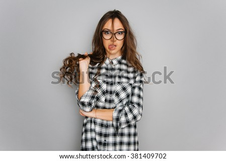 Portrait of cute teen girl wearing stylish shirt isolated on gray background fashion for teenagers in a photostudio