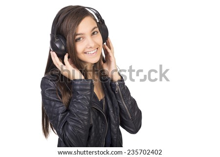 Portrait of cute teenage girl  listening music on her headphones isolated on white background - stock photo