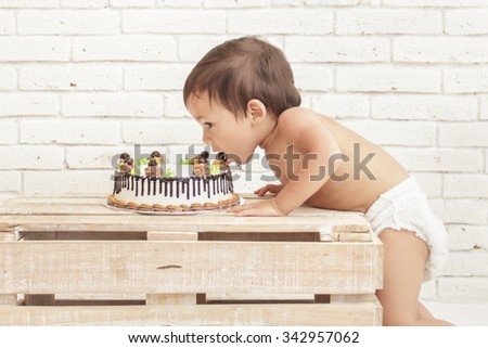 portrait of cute toddler eating his cake - stock photo