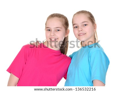 Portrait of cute twins in colored T-shirts on white background