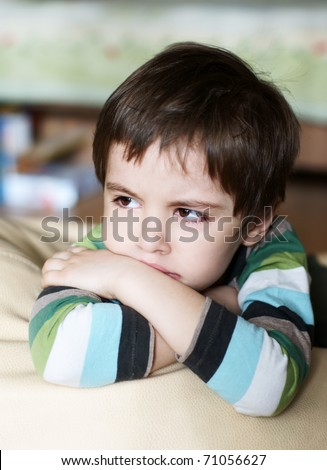 Portrait of cute upset offenced lonely little boy - stock photo
