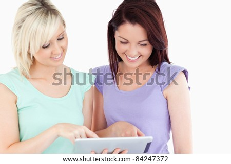 Portrait of cute women with a tablet in a studio
