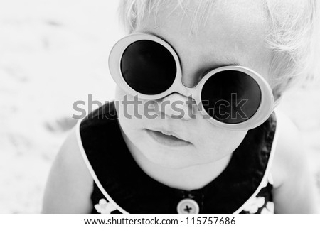 Portrait of cute 1,5 years old baby with fashin vintage sunglasses - stock photo