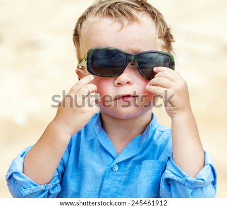 Portrait of cute 2,5 years old child with sunglasses  - stock photo