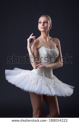Portrait of cute young blonde posing in tutu