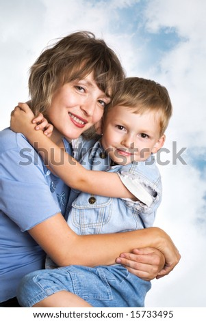 Portrait of cute young boy and his mother - stock photo