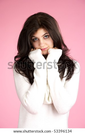 Portrait of cute young female with white sweater over pink background - stock photo