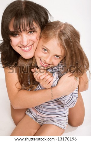 portrait of cute young girl and her mother