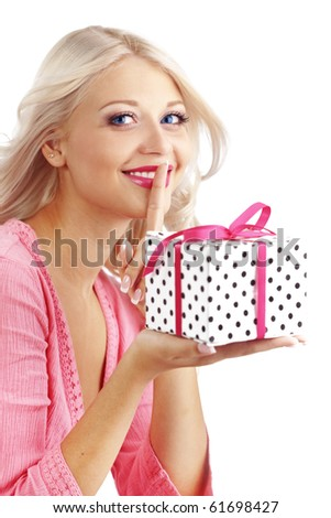 Portrait of cute young woman holding wrapped gift