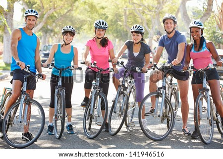 Portrait Of Cycling Club On Suburban Street - stock photo