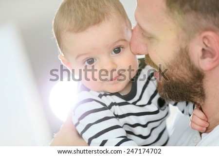 Portrait of daddy embracing baby boy - stock photo