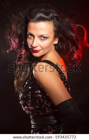 Portrait of dancing girl on disco party - stock photo