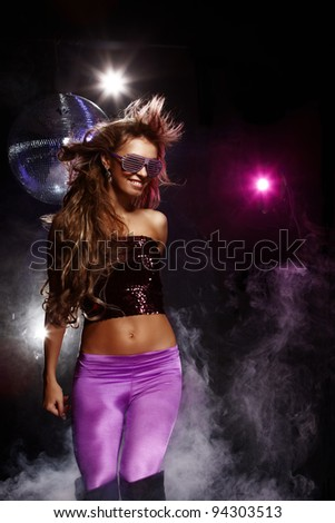 Portrait of dancing girl on disco party
