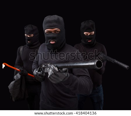 Portrait of dangerous robbers or burglaries with rifles  and crowbars over black background in studio. Studio shot. Isolated on black. - stock photo