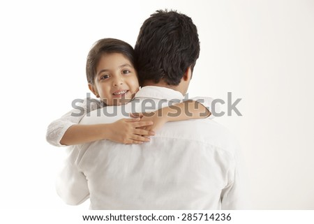 Portrait of daughter embracing father - stock photo