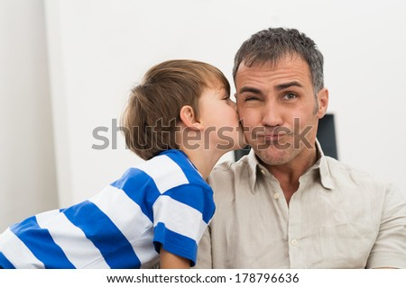 Portrait Of Daughter Kissing His Father On Cheer - stock photo