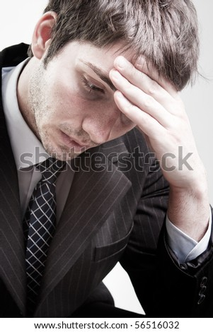 Portrait of depressed sad tired business man - stock photo