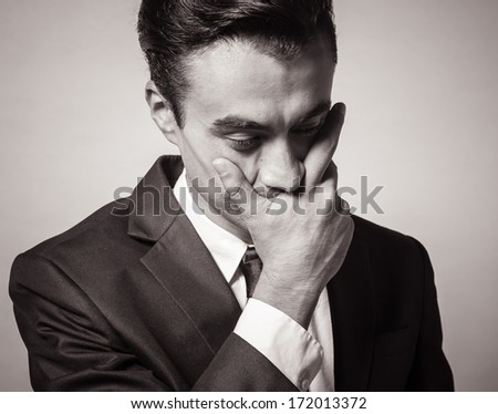 Portrait of depressed, stressed man - stock photo