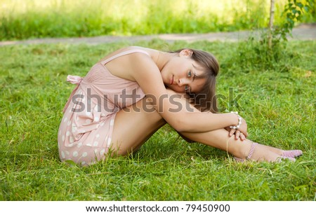 portrait of depressed teenager girl in park - stock photo