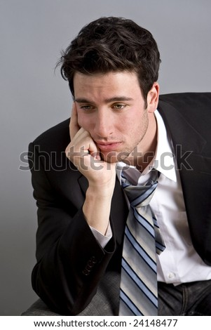 Portrait of depressed young businessman - stock photo